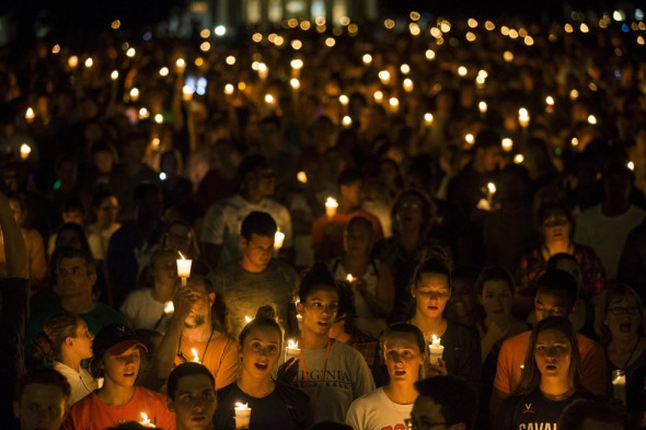 Samuel Corum/Anadolu Agency/Getty Images On Aug. 16, 2017, demonstrators with candles march along the path that white supremacists took days earlier with torches on the University of Virginia campus in Charlottesville.