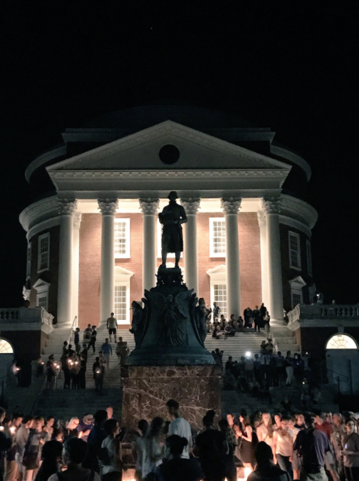 Ryan J. Reilly Demonstrators lay candles at the base of the Thomas Jefferson statue at the University of Virginia campus.