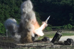 The US M270 Multiple Launch Rocket System fires an MGM-140 Army Tactical Missile during a US and South Korea joint missile drill aimed to counter North Korea's intercontinental ballistic missile test on July 5. Picture: South Korean Defence Ministry via Getty ImagesSource:Getty Images