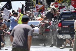 Car hits people in Charlottesville racism protest. By Ryan M. Kelly, the Daily Progress.