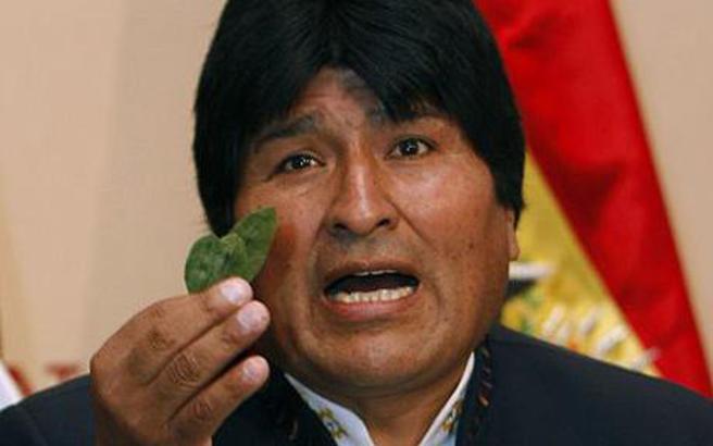 Evo Morales holding coca leaf