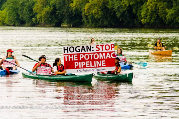 Kayactivst Potomac Pipeline protest by Anne Meador big sign with handful of kayacks