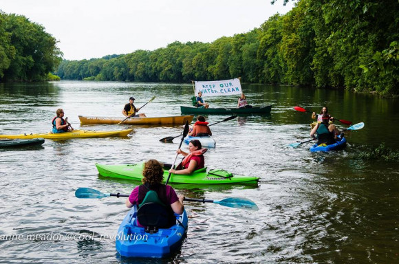 Kayactivst Potomac Pipeline protest by Anne Meador home made sign with kayaks