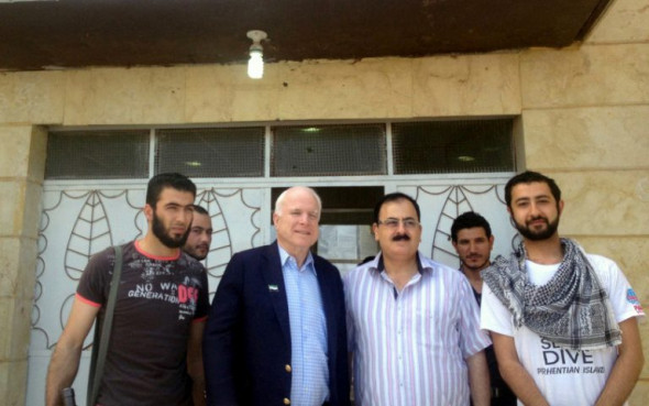 Senator John McCain in Syria with members of the U.S.-backed rebel group Northern Storm.
