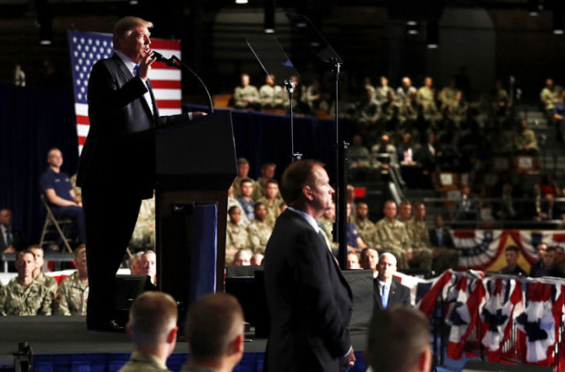 "Trump, surrounded by troops and patriotic bunting, defines his ""new"" Afghan strategy (Carolyn Kaster/AP)"