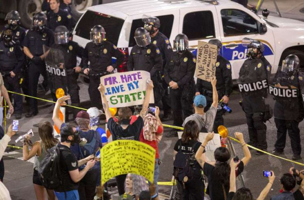 Thousands demonstrated peacefully against Trump in Phoenix on Tuesday night, before the rallies turned violent. (Photo: David McNew/Getty Images)