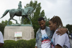 Howard University student Troy Duffie with fellow student Kaylah Clark near the statue of Confederate Gen. Robert E. Lee in Charlottesville, Va., last week. Some 50 Howard students visited the statue and the site where Heather Heyer was killed while she was protesting a white nationalist rally Aug. 12. (Cliff Owen / AP)