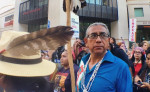 """Shannon Rivers protested Trump at the Phoenix rally on Tuesday. For Rivers, a tribal citizen of the Akimel O'odham of the Gila River Indian Community, the alliance between indigenous people and Latinos is personal. """"Many [Latinos] are our family,"""" he said.  Photo by Jenni Monet."""