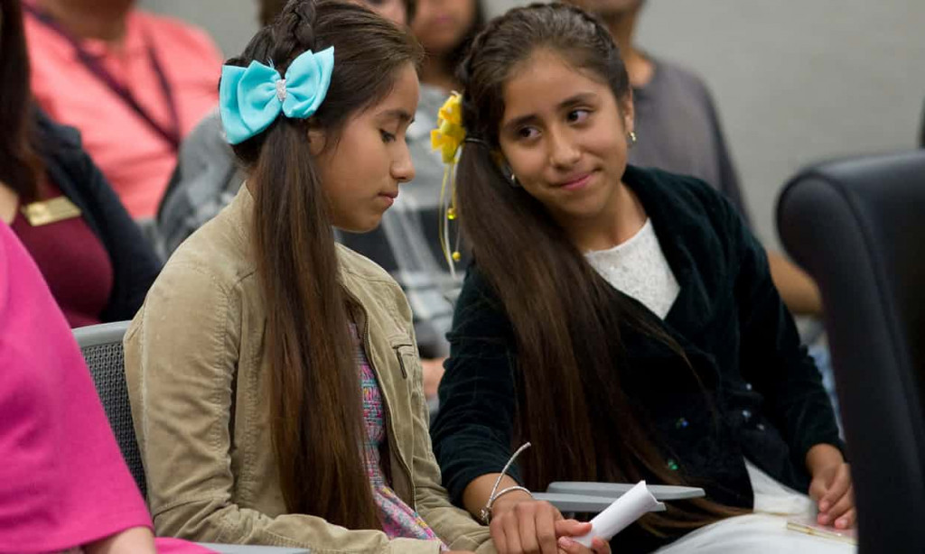 Yarely and Aracely Duarte, 12-year-old twins, at a city council meeting where they shared their story of being separated from their parents. Photograph: David Maung/EPA