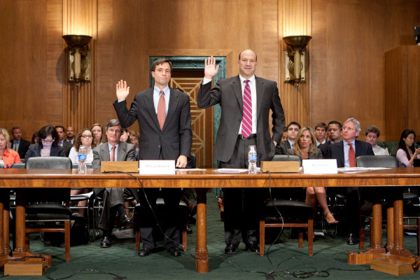 Gary Cohn, president and chief operating officer of Goldman Sachs Group Inc. (R) and Craig Broderick, managing director and head of credit, market and operational risk with Goldman Sachs, during a Financial Crisis Inquiry Commission hearing on the role of derivatives in the financial crisis, on June 30, 2010. Andrew Harrer/Bloomberg/Getty Images