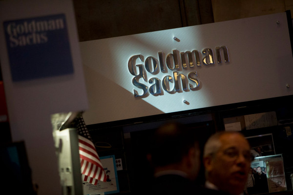 The Goldman Sachs & Co. logo at the company's booth on the floor of the New York Stock Exchange in New York City, on Friday, July 19, 2013.  Scott Eells/Bloomberg/Getty Images