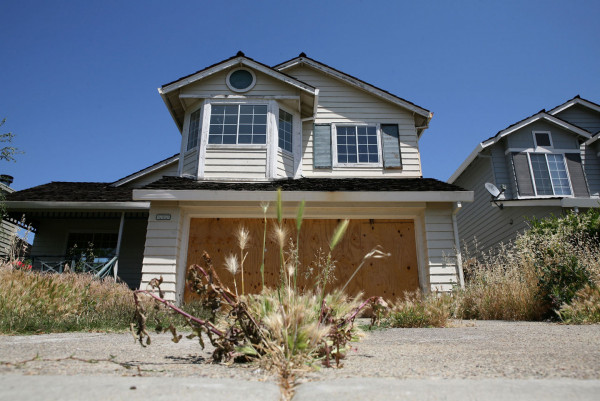 Weeds grow in the driveway of a foreclosed home May 7, 2009 in Antioch, Calif.  Justin Sullivan/Getty Images