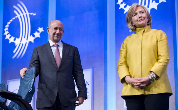 Lloyd Blankfein, chair and CEO of Goldman Sachs, (L) stands on stage with former U.S. Secretary of State Hillary Clinton during the 2014 Clinton Global Initiative annual meeting in New York on Sept. 24, 2014. Stephen Chernin/AFP/Getty Images