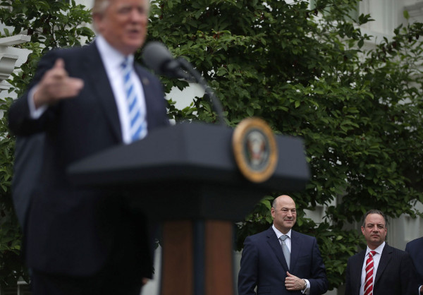 President Donald Trump speaks to community bankers as Director of the National Economic Council Gary Cohn (2nd R) and White House Chief of Staff Reince Priebus (R) listen during an event at the Kennedy Garden of the White House on May 1, 2017 in Washington, D.C. Alex Wong/Getty Images