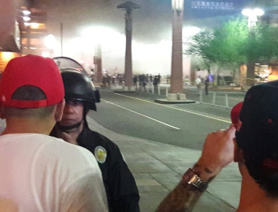 Tear gas and smoke bombs billow through the streets of Phoenix, Arizona after police attack peaceful demonstrators. Photo by AfGJ