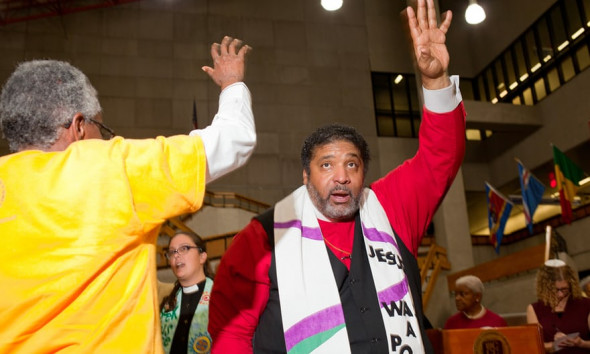 The Rev Dr William J Barber II at the Poor People's Campaign mass meeting at Wayne County Community College. Photograph: Garrett MacLean for the Guardian