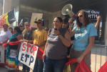 Louisiana-based organizer Cherri Foytlin addresses a crowd of protesters at Energy Transfer Partners corporate headquarters in Dallas, Texas, on Friday. Indigenous and environmental activists from across the country demonstrated against the company's pipeline projects, including the Bayou Bridge Pipeline, which would carry oil from east Texas across the sensitive wetlands of southern Louisiana. (Photo: Ethan Buckner / Earthworks)