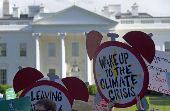 Climate protesters outside of White House. Photo by Susan Walsh for AP.