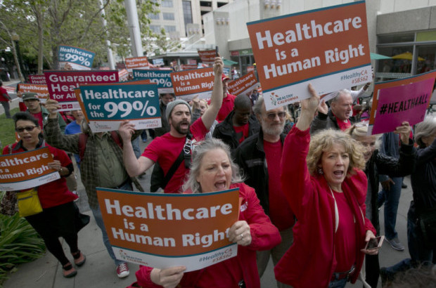 Supporters of single-payer health care march in Sacramento, Calif., in April. (Rich Pedroncelli / AP)