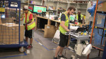 Workers pack and ship customer orders at the 750,000-square-foot Amazon fulfillment center on August 1, 2017 in Romeoville, Illinois.
