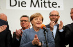 German Chancellor Angela Merkel (C) of the Christian Democratic Union (CDU) speaks to her supporters late in the evening at the CDU election event in Berlin, Germany, 24 September 2017. [Carsten Koall / EPA-EFE]