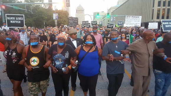 Annie Smith, the mother of the late Anthony Lamar Smith, is at center of a protest through downtown St. Louis on September 25. From Riverfront Times Protests by Danny Wicentowski