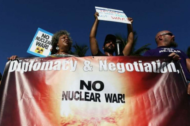 Protesters call on President Donald Trump to stop his drive to war against North Korea on August 14, 2017 in Miami, Florida. (Photo: Joe Raedle/Getty Images)