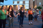 People gather and hold hands during a vigil for the victims of the Charlottesville violence, held at Calvert and Clay Streets on Sunday night. By Matthew Cole / BSMG