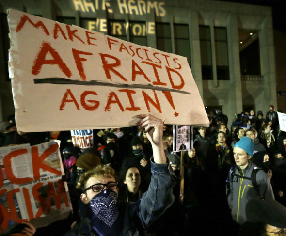 A demonstration on the University of Washington campus where far-right commentator Milo Yiannopoulos was giving a speech on Friday, Jan. 20, 2017. AP Photo/Ted S. Warren