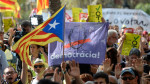 """People hold Catalan pro-independence flags outside the high court in Barcelona, Spain, on Thursday. After a daylong protest that lasted well into the night, several thousand independence supporters gathered again in front of the high court in what influential separatist organizations said would be a """"permanent mobilization"""" until detained Catalan officials are freed. Josep Lago/AFP/Getty Images"""