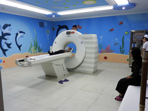 "The Okryu Children's Hospital is a six-story, 300-bed facility across from Pyongyang's towering maternity hospital. U.S. sanctions on the DPRK prevent further entry of machines like the pictured CT scan. While defiantly proud of the health care system, Dr. Kim Un-Song spoke of her anger as a mother: ""This is inhumane and against human rights. Medicine children need is under sanctions."""