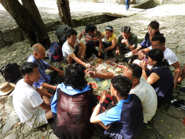 "While walking up a path to the Pakyong Waterfall, over 100 km south of Pyongyang, I met a group of men and women grilling meat over a fire. At the waterfall, other picnickers ate grilled meat, fish, boiled eggs, kimbap (""Korean sushi""), and kimchi (fermented vegetables), drinking beer and soju (alcoholic drink). Having lived in South Korea, this scene is one I saw countless times along the sea or in the mountains. While walking up a path to the Pakyong Waterfall, over 100 km south of Pyongyang, I met a group of men and women grilling meat over a fire. At the waterfall, other picnickers ate grilled meat, fish, boiled eggs, kimbap (""Korean sushi""), and kimchi (fermented vegetables), drinking beer and soju (alcoholic drink). Having lived in South Korea, this scene is one I saw countless times along the sea or in the mountains. Watch clips here and here."
