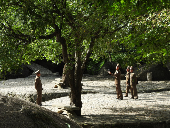 Beneath a tree near the waterfall, soldiers took turns being photographed with the waterfall as a backdrop. Later, they repeated at the waterfall.  Beneath a tree near the waterfall, soldiers took turns being photographed with the waterfall as a backdrop. Later, they repeated at the waterfall. Watch here.