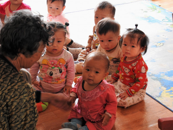 Inside the child-care center of the Jangchon Cooperative Farm. The cooperative also includes a cultural center for meetings and events, and rows of greenhouses.