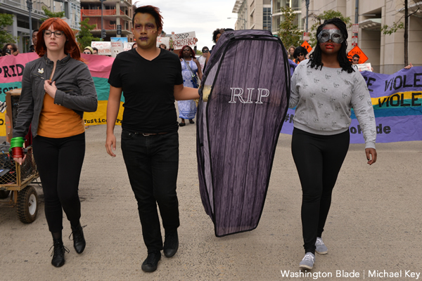 Activists affiliated with No Justice No Pride march around the Walter E. Washington Convention Center on Oct. 28, 2017, just before the 21st annual Human Rights Campaign National Dinner was about to take place. (Washington Blade photo by Michael Key)