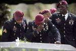 Members of the 3rd Special Forces Group, 2nd battalion cry at the tomb of US Army Sgt. La David Johnson at his burial service in the Memorial Gardens East cemetery on October 21, 2017, in Hollywood, Florida. Sgt. Johnson and three other US soldiers were killed in an ambush in Niger on October 4, 2017. (Photo: GASTON DE CARDENAS / AFP / Getty Images)