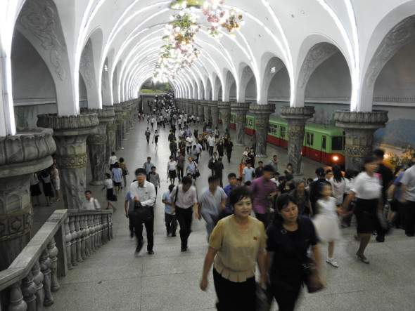 Pyongyang's metro is a three-minute escalator ride below ground into a series of marble stations with elaborate chandeliers and beautiful wall paintings. Passengers ranged from well-dressed people, women in nice dresses and high heels, and others in casual blouses and slacks. Mosaics and engravings depict scenes of farming, construction, factories, rebuilding. Riding the metro costs the equivalent of a few cents. The tour group, Uri Tours, writes that half a million people ride the subway daily. Watch a clip of the metro here.