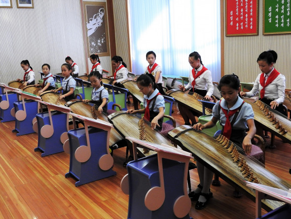 Students at the Mangyongdae Children's Palace playing the traditional Korean instrument, the kayagun. Listen to their performance here.
