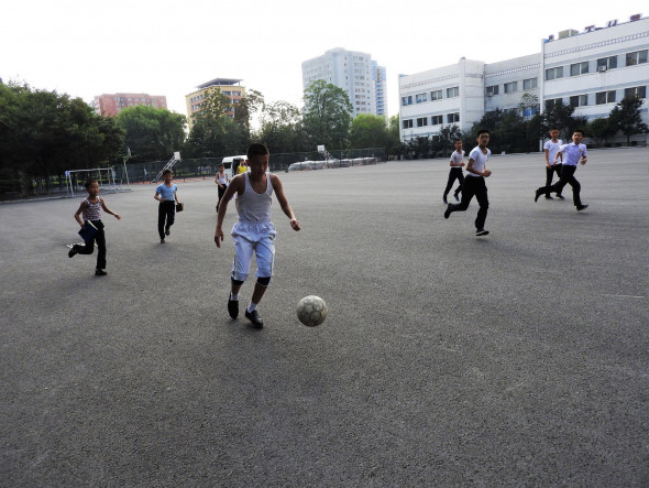 Students playing football outside the Middle School.  Watch the clip here.