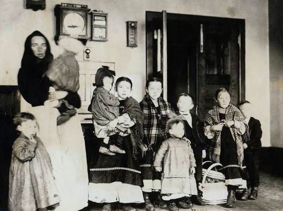 Polish woman and her nine children at Ellis Island. (Photo courtesy of Ellis Island Immigration Museum)