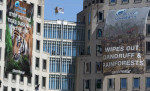 Greenpeace activists hung banners on the headquarters of Procter & Gamble to draw attention to palm oil plantations and deforestation. Credit: Tim Aubry/Greenpeace