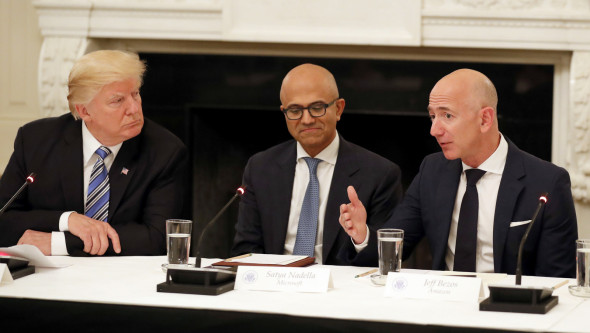 President Donald Trump, left, and Satya Nadella, Chief Executive Officer of Microsoft, center, listen as Jeff Bezos, Chief Executive Officer of Amazon, speaks during an American Technology Council roundtable in the State Dinning Room of the White House, June 19, 2017, in Washington. (AP/Alex Brandon)