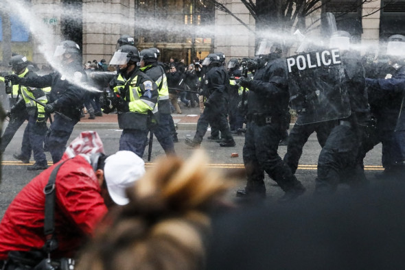 Police fire pepper spray at protesters during a demonstration in downtown Washington after the inauguration of President Donald Trump on Jan. 20, 2017. Photo: John Minchillo/AP