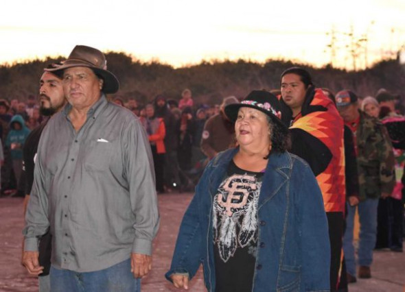 Doug Duncan and Susie Pinole entering circle with Round Valley California Indian dancers/singers to perform.