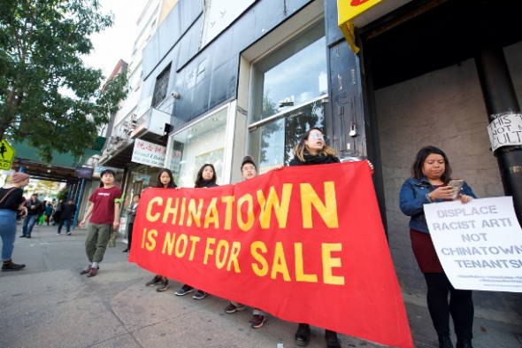 Residents and advocates protest gentrification of Chinatown outside the James Cohan Gallery. (WNV/Louis Chan)