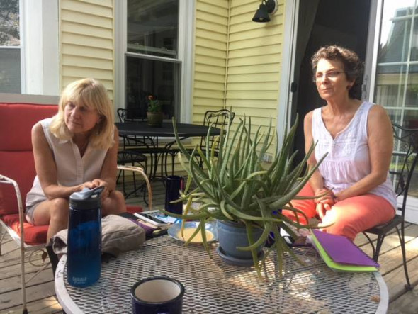 Abby Huntoon (left) and Roberta Zuckerman meet with other members of Protect South Portland who have been raising funds to fight the pipeline plan. Credit: Sabrina Shankman