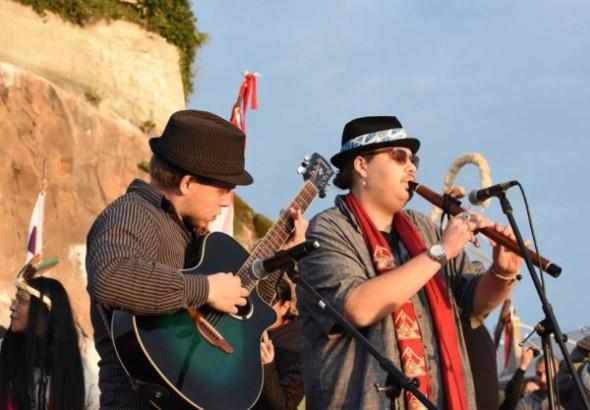 Cody Blackbird (Dakota, Eastern Band Cherokee) and accompanist performing.