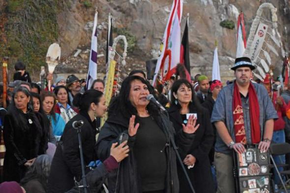 LaNada War Jack speaking. Left to right, Rochelle Diver (IITC), LaNada War Jack, Andrea Carmen (Exec. Dir. IITC), Cody Blackbird.
