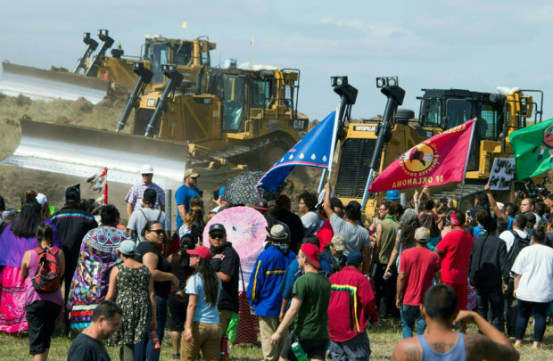The Standing Rock tribe and their supporters carried out months of protest in an effort to stop the Dakota Access Pipeline from being built. The pipeline carries crude oil under the Missouri River, which the tribe relies on for drinking water and considers sacred. Credit: Robyn Beck/AFP/Getty Images