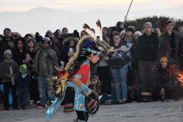 Young powwow dancer performing